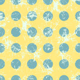 Seamless vector pattern. Creative geometric yellow pastel background with blue circles. Texture with attrition, cracks and ambrosia. Old style vintage design vector illustration
