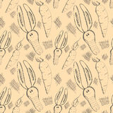 Seamless vector pattern. Cute background with hand drawn rabbits and carrot. Royalty Free Stock Photography