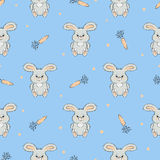 Seamless vector pattern with cute bunnies and carrots Royalty Free Stock Image
