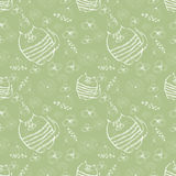 Seamless vector pattern. Cute green background with hand drawn cats and flowers Stock Photos