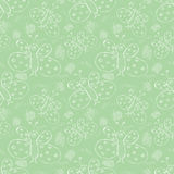 Seamless vector pattern. Cute pastel green background with hand drawn butterflies and scribbles. Royalty Free Stock Photos