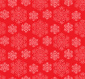 Seamless vector pattern. Delicate snowflakes on a red background Stock Illustration