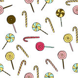 Seamless vector pattern with doodle hand drawn lollipops. Color illustration of cute desserts Stock Images