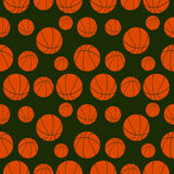 Seamless vector pattern with elements of orange basketballs Stock Image