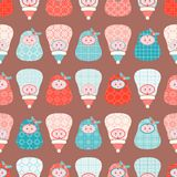 Cute Christmas matryoshka dolls seamless vector pattern in pink and aqua stock illustration