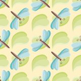 Dragonfly over leaf seamless vector pattern over yellow vector illustration