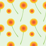 Seamless vector pattern with flowers. Background with orange dandelions on the grey backdrop. Stock Photo