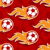 Seamless vector pattern with football soccer ball icons and flames. Seamless pattern with football soccer ball icons and flames. Vector illustration. Ideal for royalty free illustration