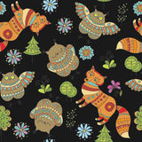 Seamless vector pattern with foxes, owls and trees Stock Images