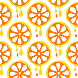 Seamless vector pattern with fruits. Symmetrical background with closeup oranges on the white backdrop. Stock Images