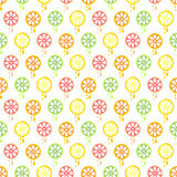 Seamless vector pattern with fruits. Symmetrical background with limes, lemons, oranges and grapefruits on the white backdrop Royalty Free Stock Photography