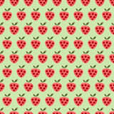 Seamless vector pattern with fruits. Symmetrical background with red strawberries on the green backdrop Stock Photos