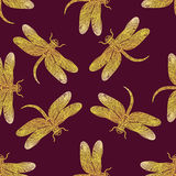 Seamless vector pattern with golden shiny dragonfly Royalty Free Stock Photography