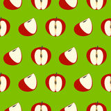 Seamless vector pattern, green background with red apples Stock Images