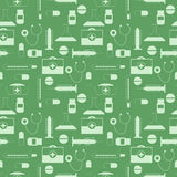 Seamless vector pattern,green symmetrical background with medical tools and pills Stock Photos