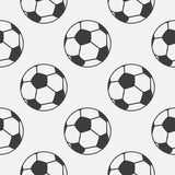 Seamless vector pattern, grey background with elements of black soccer balls Stock Photo