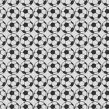 Seamless vector pattern, grey symmetrical background with elements of black soccer balls Royalty Free Stock Photos