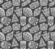 Seamless vector pattern with hand drawn fancy masks in african s Royalty Free Stock Images