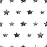 Seamless vector pattern with hand drawn stars. Seamless vector modern pattern with hand drawn stars shapes. Black and white Stock Photo