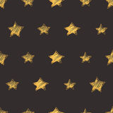 Seamless vector pattern with hand drawn stars shapes. Seamless vector modern pattern with hand drawn stars shapes. Gold in dark grey background Stock Photo