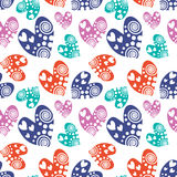 Seamless vector pattern with hearts. Background with colorful hand drawn ornamental symbols on the white. Decorative repeating orn Stock Images