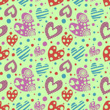 Seamless vector pattern with hearts. Background with different colorful hand drawn ornamental  Stock Photography