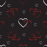 Seamless vector pattern from hearts on a black background, for St. Valentine`s D Royalty Free Stock Photos