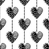 Seamless vector pattern with hearts. Black and white abstract background with drawn elements and ornamental symbols. Decorative repeating ornament stock illustration