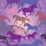 Seamless vector pattern with horses on purple background Royalty Free Stock Photo