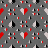 Seamless vector pattern with icons of playing cards. Black, red and grey repeating background. Royalty Free Stock Photo