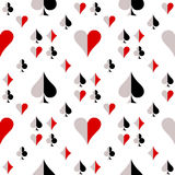 Seamless vector pattern with icons of playing cards. Black, red and white repeating background. Royalty Free Stock Images