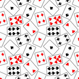 Seamless vector pattern with icons of playings cards. Bright red, black and white background. Royalty Free Stock Photos
