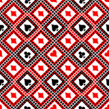 Seamless vector pattern with icons of playings cards. Bright red, black and white symmetrical geometric background. Royalty Free Stock Photography