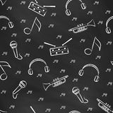 Seamless vector pattern with the image of  drum, microphone, pipe, headphones and note Stock Images