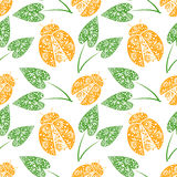 Seamless vector pattern with insects, chaotic background with bright decorative orange closeup ladybugs and green leaves Stock Photos