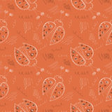 Seamless vector pattern with insects. Cute hand drawn background with ladybugs and scribble on the red backdrop Stock Photos