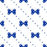 Seamless vector pattern with insects, symmetrical background with blue butterflies and dots on the white backdrop Stock Images