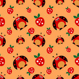 Seamless vector pattern with insects, symmetrical background with bright cute comic ladybugs and strawberries, on the red backdrop. Series of Animals and Royalty Free Stock Image