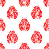 Seamless vector pattern with insects, symmetrical background with bright decorative red ladybugs, over white backdrop Stock Photography