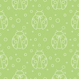 Seamless vector pattern with insects, symmetrical  green background ladybugs and dots Stock Photos