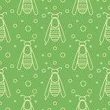 Seamless vector pattern with insects, symmetrical  green background with wasps and dots.  Stock Images