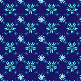 Seamless vector pattern of light blue bright snowflakes over a deep blue background. stock illustration