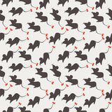 Seamless vector pattern, light pastel background with mouses, grey silhouette with red bows over grey backdrop Royalty Free Stock Photography