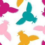 Seamless vector pattern with magenta cyan yellow owls. royalty free stock images