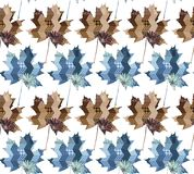Seamless vector pattern with maple leaves in blue and brown tones. Patchwork Stock Photography