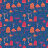Seamless vector pattern with Mushrooms orange and pink on blue background. stock photos