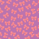 Seamless vector pattern with pastel  bows on a tile  background. Royalty Free Stock Images
