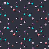 Seamless vector pattern with pink, mintm beige stars on dark grey background. Stock Image
