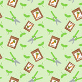 Seamless vector pattern with pruners and packages with seeds of carrot on light green background. Stock Images