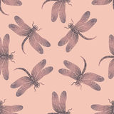 Seamless vector pattern with purple shiny dragonfly on a tender pink background. Stock Images